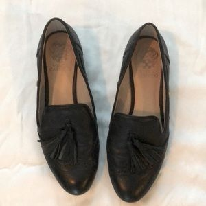 Black Vince Camuto flats with a tassel
